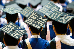 Graduates with Debt written on caps
